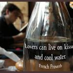 French cafe scene and proverb that lovers can live on kisses and cool water