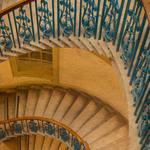 a photograph of a winding circular staircase