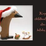 penguin with santa hat, rocking horse, and spinning top