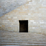 A photograph of stairs and doorway of a modern stone building in Jerusalem, Israel
