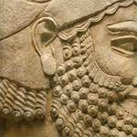 photo of a bas relief sculpture in profile of an Assyrian man