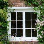 photo of climbing roses around a cottage window