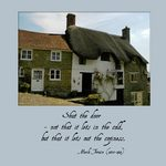 photo of a cottage on a hill with a quote by Mark Twain about coziness