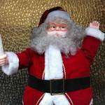 santa claus figure holding candle
