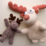 photo of two reindeer soft toys holding hands as friends