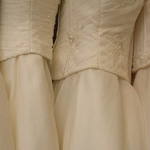 photo of two cream colored wedding gowns