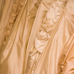 photo of the detail of a decorated wedding gown