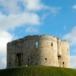 a photograph of Clifford's Tower ancient monument in the city of York in England