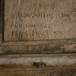 photo of details of writing dating to 1846 and earlier carved into the door of the Church of the Holy Sepulchre in Jerusalem