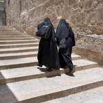 photo of two nuns walking up stone steps near the Church of the Holy Sepulchre in Jerusalem