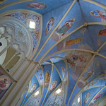 photo of the interior of a church in Jerusalem showing the decorated blue ceiling and vaulted arches