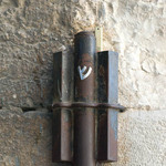 photo of a large mezuzah fastened to a wall at the entrance to a building in Jerusalem