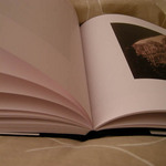 photo of an open book showing a photograph and text
